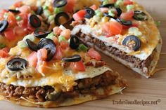 Better Than Taco Bells Mexican Pizza.  To make Veggies - would omit the ground turkey or sub it with TVP.