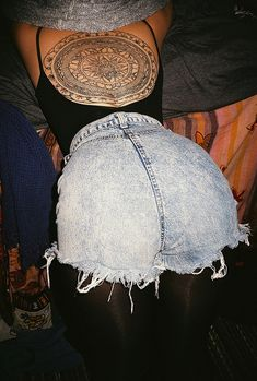 Not sure what's up with the stonewashed jean shorts, but that back tattoo is gorgeous!