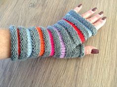Handknitted fingerless gloves . Ready to ship Size S/M, length 20 cm Acrylic yarn Hand wash et dry flat recommended All the items in my shop are washed with mild detergent and are ready to wear Please note that the colors may vary slightly due to monitor settings Thank you for visiting