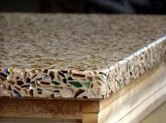 This recycled glass countertop is much cheaper than granite. There's three more eco-friendly countertop options .... #Eco-Friendly #eco-friendlyliving