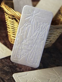 The oplatek, embossed with a Christmas scene, is shared among family members before Christmas Eve dinner in Poland. First the husband gives some to the wife, along with a blessing he wishes her to have or an apology. Then the wife does the same for him, and then they do the same for the children.