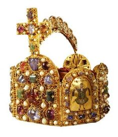 """The """"Crown of Charlemagne""""Gold, cloisonné enamel, precious stones, pearlsEight hinged plates form the octagonal body of the imperial crown. Four smaller plates bear pictorial representations from the Old Testament in cloisonné enamel; the four main plates of differing sizes are decorated solely by precious stones and pearls in raised settings."""