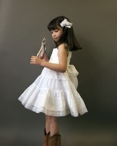 I think this is along the lines of the initial flower girl concept, no? (Linen Lace Silk and Cotton Flower Girl Nicole  by FoxnLily on Etsy, $200.00)