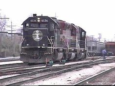 Homewood, Illinois is located at the southern end of Illinois Central's Markham Yard.    Here, two IC SD40-2's, spliced by a leased EMD SD45, have just brought up a string of covered hoppers from the south.