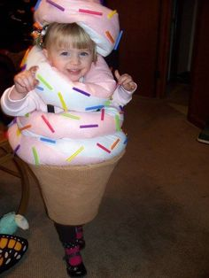 Twist ice cream cone Halloween Costume. Upside-down lampshade held up with suspenders, Felted fabric tubes stuffed with poly fill and cut up straws for sprinkles.