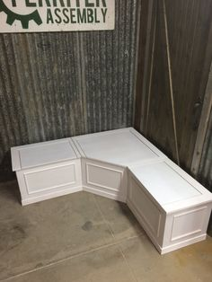 Corner Bench with storage beneath seating. With German made, tension adjustable, lid stays to protect those small fingers. Great space saver. No chairs to clutter the major walkways of your kitchen. White laquer Finish. Measures 60 x 60 x 18 x 18. Cushions not included. Our benches