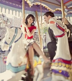 on a carousel. I would LOVE to do a couples engagement photos at the fair!