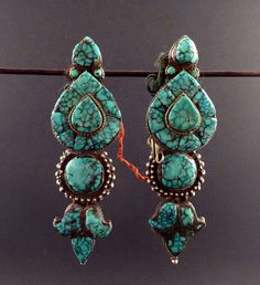 Old  silver and turquoise tibetan earrings, tibetan silver, turquoise tribal earrings, jewellery from Himalaya, ethnic tribal earrings by ethnicadornment on Etsy https://www.etsy.com/listing/209854674/old-silver-and-turquoise-tibetan