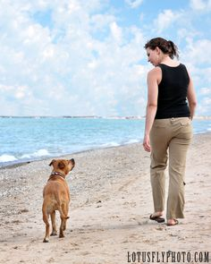 Portrait shoots with pets and their parents are some of my favorites to do. There is nothing more fulfilling than capturing a moment of true love in any relationship, whether it be one between people or people and their pets.    pet photography, lake, water, man's best friend, pitbull, pit bull, Milwaukee photographer, Lake Michigan, beach, love, LotusFly Photography