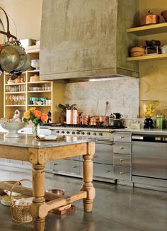 So luv the cook area! What a fabulous range & the farm table island with a galvanized top is so handsome...