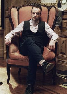 Holmes a-pondering in his awesome chair.