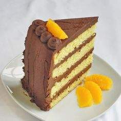Orange Cake with Easy Chocolate Truffle Frosting - a homemade orange scratch cake gets filled and frosted with an easy to make chocolate truffle frosting which is made from only 2 ingredients.