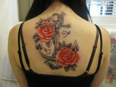 Grey ink anchor with red roses tattoo on back for girls