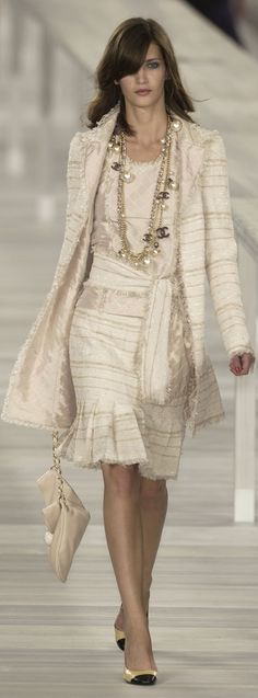 This Chanel dress is all a white/cream colour. This means it is counted as Monochrome.
