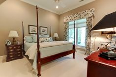 Guest bedroom overlooking the private screened-in porch. Designed and built by Ramage Company.