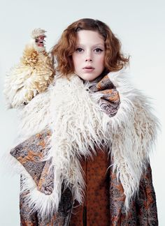 Chick Magnet - Come snow or come sleet, this brocaded piece—reminiscent of the greatcoats worn by the falconers of Mongolia—will keep you (if not your frizzle chicken) toasty. Model Natalie Westling wears a Dries Van Noten coat with faux-fur collar ($1,745) and jacket ($1,390); Barneys New York stores.