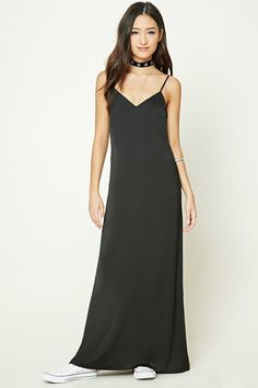 A satin maxi dress featuring a V-neckline, adjustable cami straps, and a concealed back zipper.