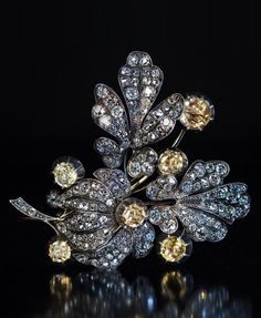 An early Victorian silver-topped gold, diamond and topaz brooch, 1840s-50s. Naturalistically modelled as a spray of flowers, finely crafted in silver-topped gold and embellished with champagne colour topazes and sparkling bright white old mine cut diamonds.