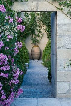 View through a doorway in Provence, France. Photo by Clive Nichols
