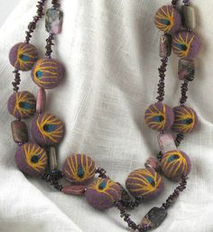felt beads with needle felted detail