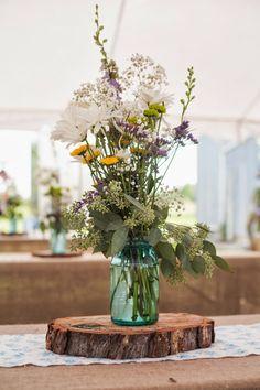 cute idea of tree cross section underneath flowers (aqua mason jar...) for home deco, also stolen from a wedding blog