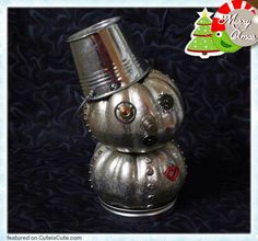 Steampunk Christmas decoration. Looks like two mini painted pumpkins.