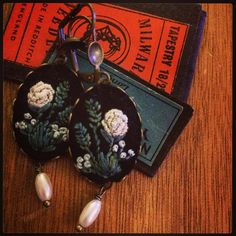 Embroidered black floral earrings by Barbara Schar.