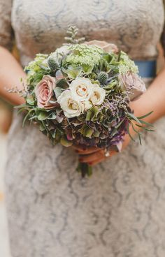 Bridesmaid bouquets featured roses, hydrangeas, and thistles.  Bridesmaid Dresses: WattersfromLila's Bridal Boutique  Floral Designer:Weddings & Blooms