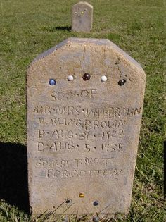 Depression era headstone of a 12-year-old boy. Made of concrete and embedded with some of his marbles.