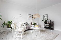 Un apartamento blanco y nórdico