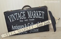 Cool Junk Signs for the Vintage Market. Custom stenciled vintage suitcase and upcycled t-square arrow sign. From MySalvagedTreasures.com