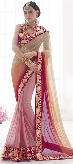 This sari is so pretty, but i'm not sure about the earrings and mang tikka