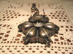 Vintage brass six compartment pill box with bird top