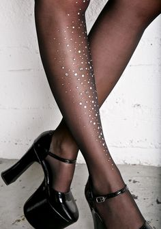 Galaxy Glimmer Tights cuz you were born from stars, babe. These gorgeous tights feature a sleek sheer black nylon construction, high waist, and multi sized glitzy rhinestones runnin' down one leg.