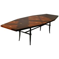 Rare Dining Table by Tommi Parzinger | From a unique collection of antique and modern dining room tables at https://www.1stdibs.com/furniture/tables/dining-room-tables/
