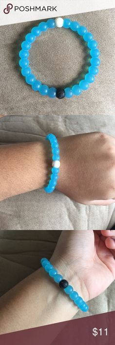 NWOT Size M Blue Lokai Bracelet Perfect condition, NWOT! Blue colored Lokai bracelet. Authentic. Size M Lokai Jewelry Bracelets