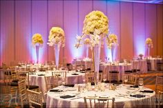 tall glass vase, lush white floral centerpiece, creme chiavari chairs with black cushion, speciality linens, all white & with a hint of black wedding decor, custom lighting, holland photo arts photography, wedding planning by Stacy Black Becher of Caroline LaRocca Event Design