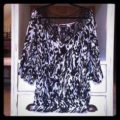 Black and white blouse Black and white pattern blouse with crochet detail around neckline and tie closure. Elastic waistband and detailing on sleeves. Brand new without tag, never worn, no flaws. Offers considered through blue offer button. No trades. Lane Bryant Tops Blouses