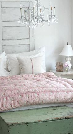 pretty bedroom, pink eiderdown, old painted wooden box and headboard