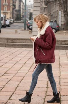 Burgundy red aviator jacket for stylish winter outfit.