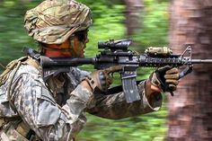 A soldier advances and fires at enemy combatants during a field training exercise at Fort Bragg, N.C., Aug. 24, 2016. Army photo by Staff Sgt. Jason Hull