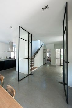 Concrete floor with thin black frame doors