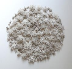 The paper art creations of the American artist Rogan Brown who designs then cuts by hand or laser thousands of paper microorganisms, including tree moss, cell