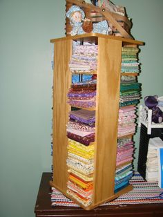 CD holder = Fabric storage! This could work for smaller pieces!  Very clever.