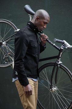 Snap-collar coat. Bike.