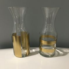 Wine carafes for vases | Spray painted w/ gold spray paint  (Dollar Tree)