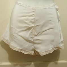 1940's vintage women's briefs Authentic 1940's women's panties. Excellent condition. Most discoloration came out after a long soak in oxyclean. Sold AS IS. Tag says rayon fabric.  Tag says size 26 (inches)  Does not provide stretch. Vintage Intimates & Sleepwear Panties