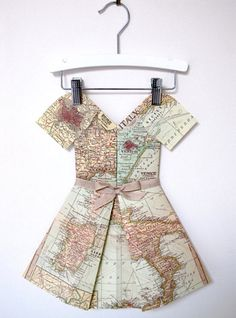 Folded Paper Dresses look like large-scale origami pieces made of folded maps and other cool-looking printed paper.