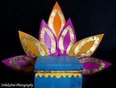 Ganesha-Seat-craft - via ArtsyCraftsyMom.com - Ganesh Chaturthi Crafts and Activities to do with Kids - Make a Clay Ganesha, decorate, Ganesha's throne & umbrella, rangoli ideas, recipes, books and more