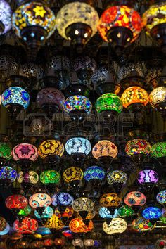 Row of traditional handmade turkish lamps in souvenir shop photo